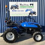 Side View of Blue Solid Compact Tractor