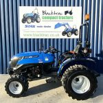 Side Profile of Blue Solid Compact Tractor