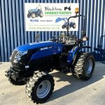 Front of Blue Solid Compact Tractor