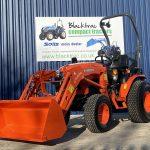 Orange Kubota Compact Tractor - Lowered Arm
