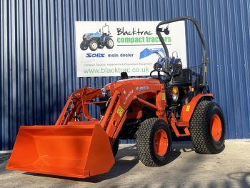 Orange Kubota Compact Tractor - Lowered Arm