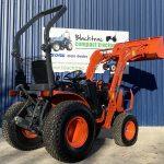 Back View of Orange Kubota Compact Tractor