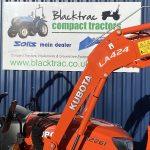 Orange Kubota Compact Tractor Arm