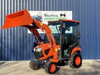 Orange Kubota Compact Tractor Arm Raised