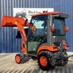 Orange Kubota Compact Tractor