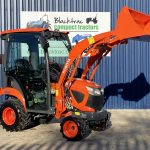 Orange Kubota Compact Tractor Arm Raised