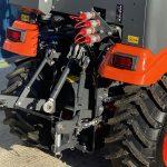 Back of Orange Kubota Compact Tractor
