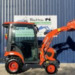 Side Profile of Orange Kubota Compact Tractor