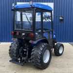 Backend of Blue Solid Compact Tractor