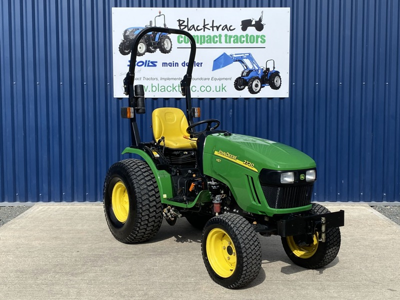 A green and yellow John Deer compact Tractor form Blacktrac.
