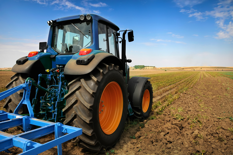solis compact tractor on farm