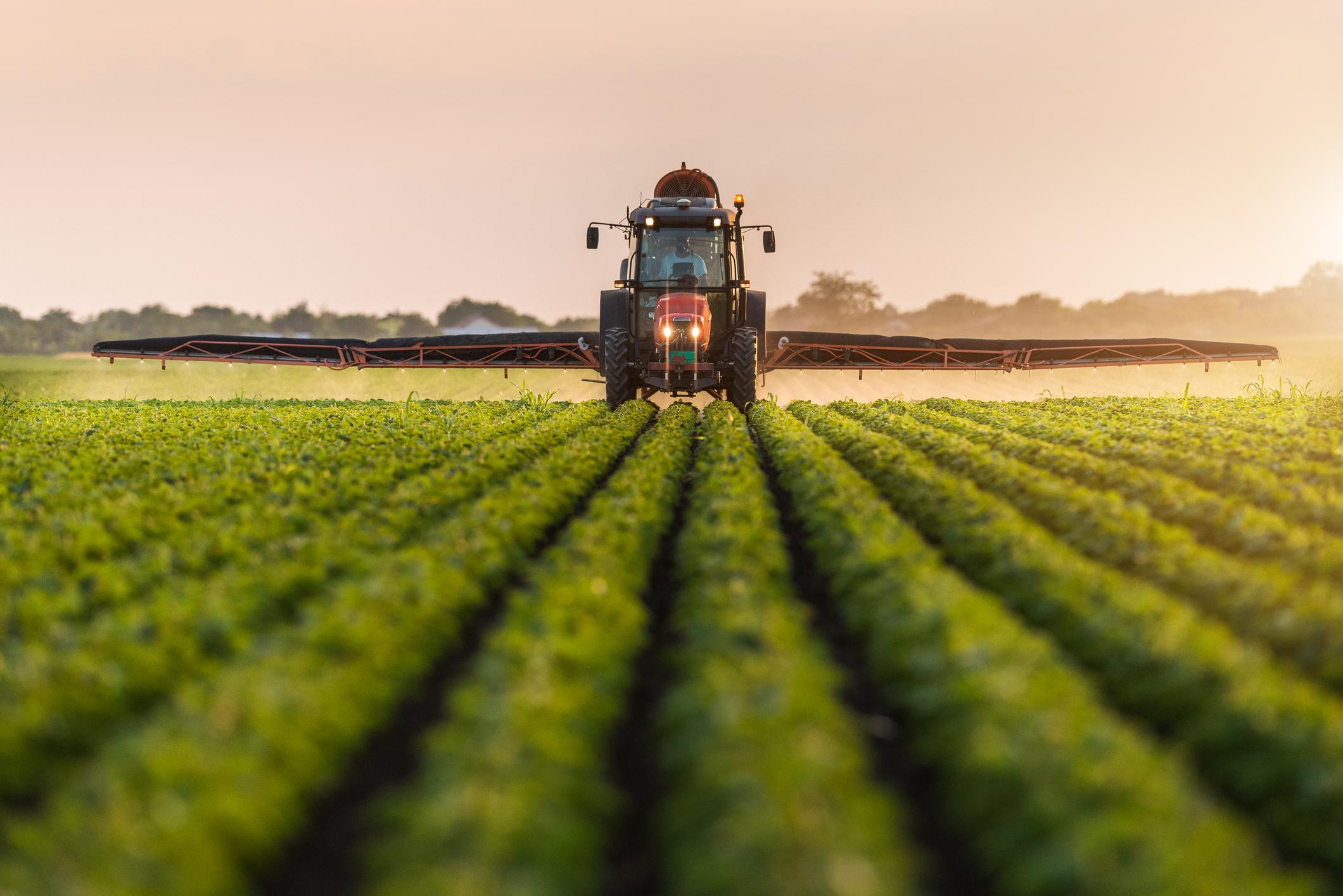 HST Tractor Spraying field