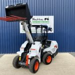 Front view of Bobcat L23 Loader with Muck Fork