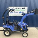 Side view of blue Iseki TXSG24 4WD HST Compact Tractor