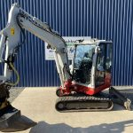 Front view of Takeuchi TB240 Mini Digger with Engcon Tilt Rotator Head & Bucket